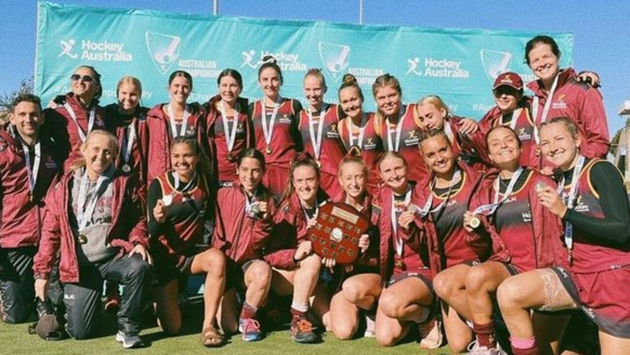 Ipswich hockey achiever Sara Rogers (back right) celebrates her first Queensland under-18 coaching success with her team at the national titles in Tasmania.
