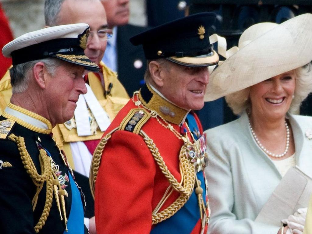 Prince Charles and the Duke of Edinburgh with Camilla, who is said to have decided to forgo the title of 'Queen' and instead be 'Princess Consort' on Charles becoming king.