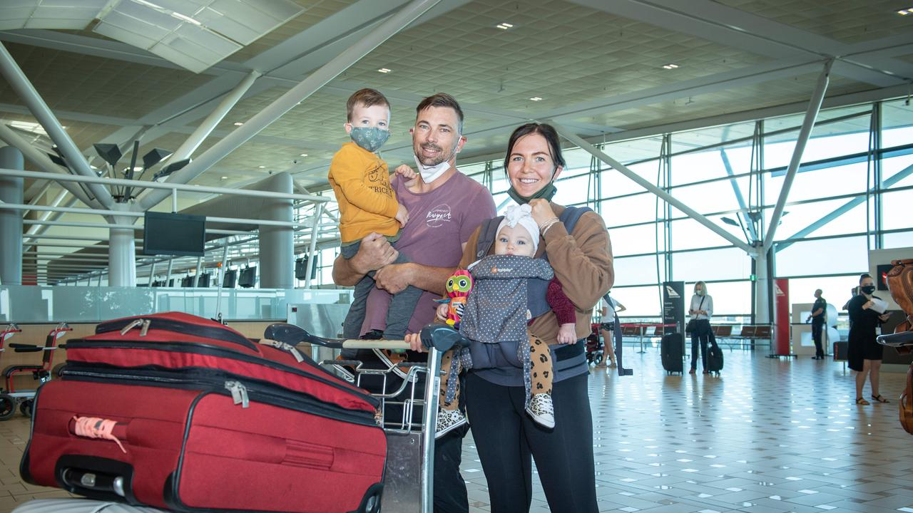Peter and Allanah Watling with their seven-month-old baby Gigi and three-year-old son Archie about to board the first flight to New Zealand as part of the travel bubble. PICTURE: Brad Fleet