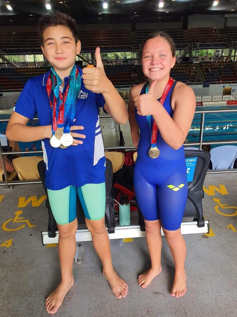 Medal-winning Waterworx Swimming Club squad members Doug Weaver and Isla Martin.