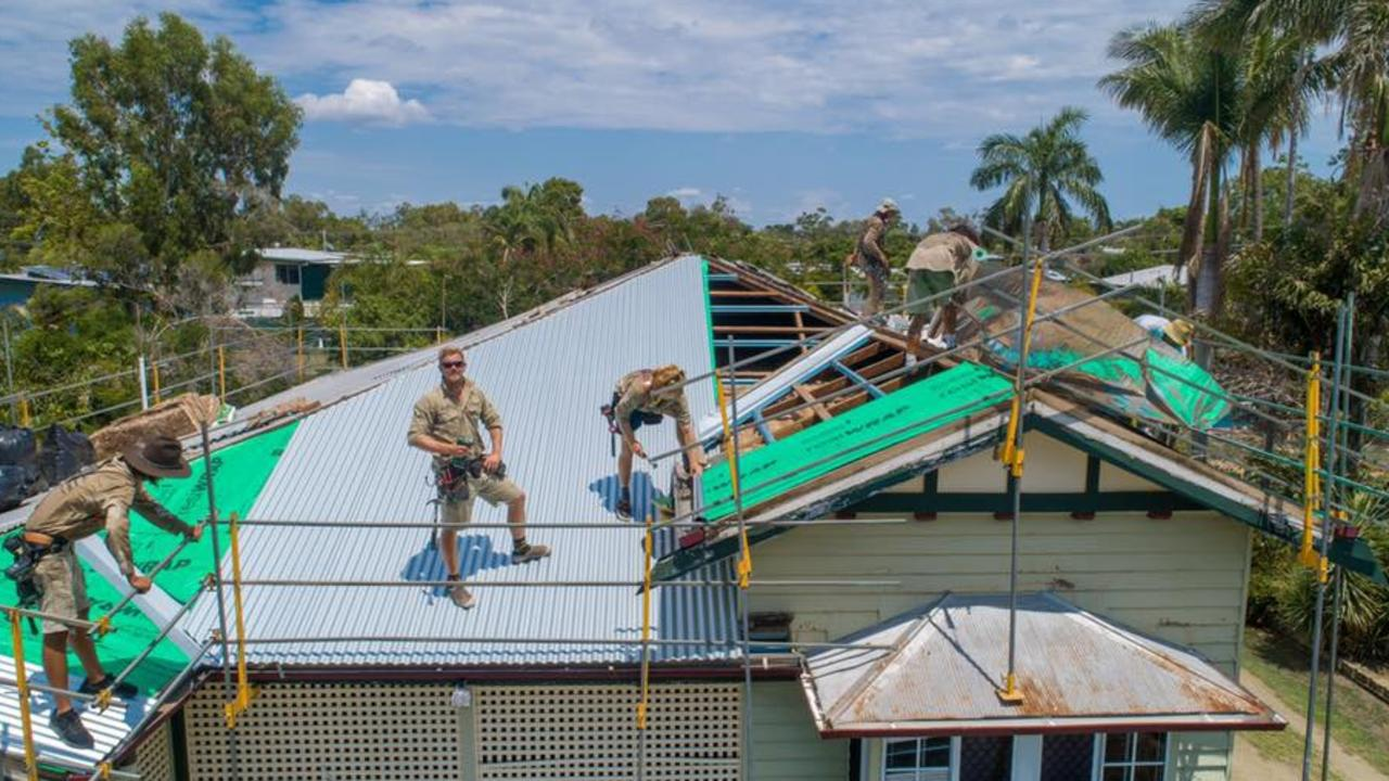 Nick Phillips and the Flashpro Roofing team working on a roof.
