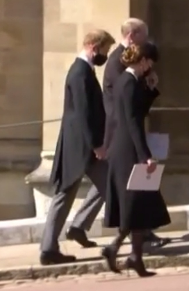 Kate Middleton, Prince Harry and Prince William walking together after the funeral service for Prince Philip. Picture: 7 NEWS