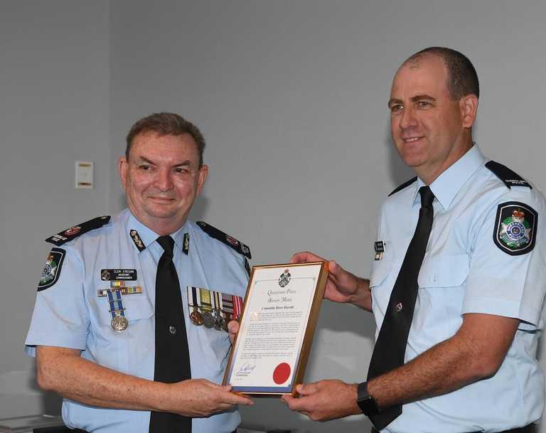 Queensland Police Medals - (L) Clem O'Regan (Asst Comm. Central Region) presents bravery award to Cnst Drew Harold.