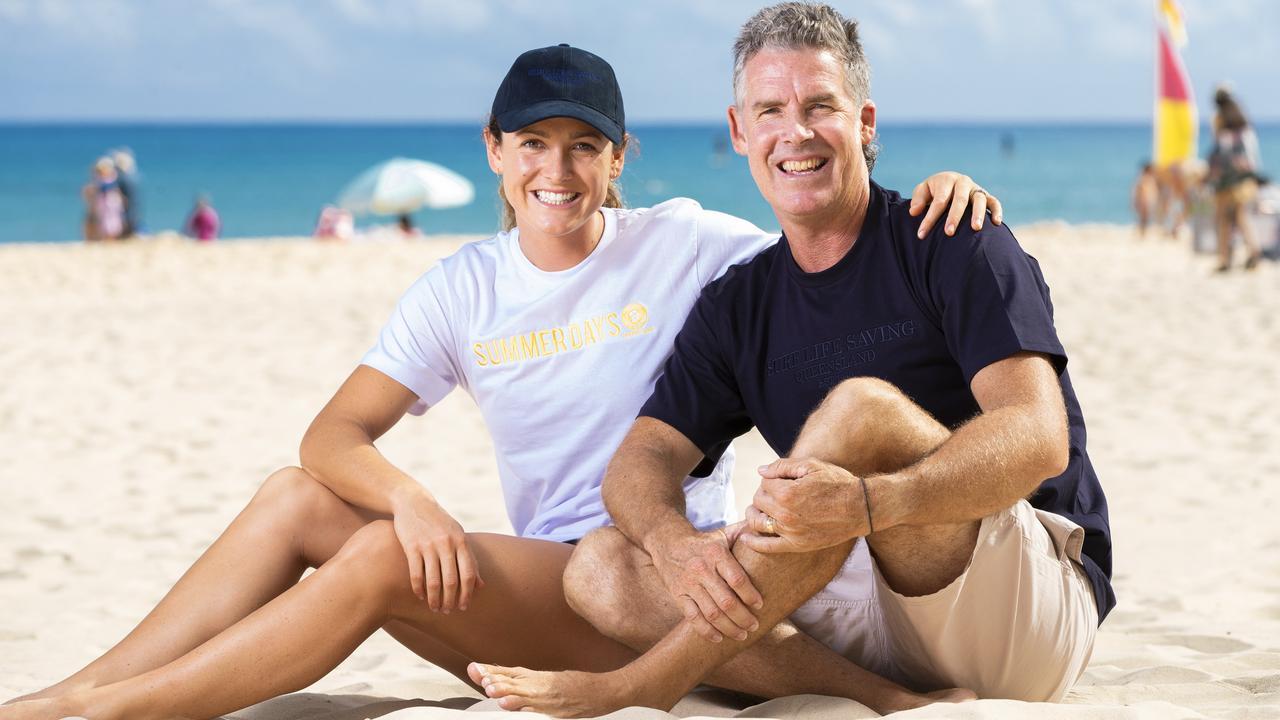 Surf Life Saving athlete Jordan Mercer with dad and legend of the sport Darren Mercer on Noosa Main Beach. Picture: Lachie Millard