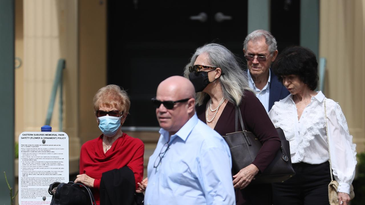 Mrs Caddick's brother Adam Grimley and parents Ted (far right) and Barbara (far left) attended a funeral service for the missing fraudster at an Eastern Suburbs memorial park several weeks ago. Picture: John Grainger
