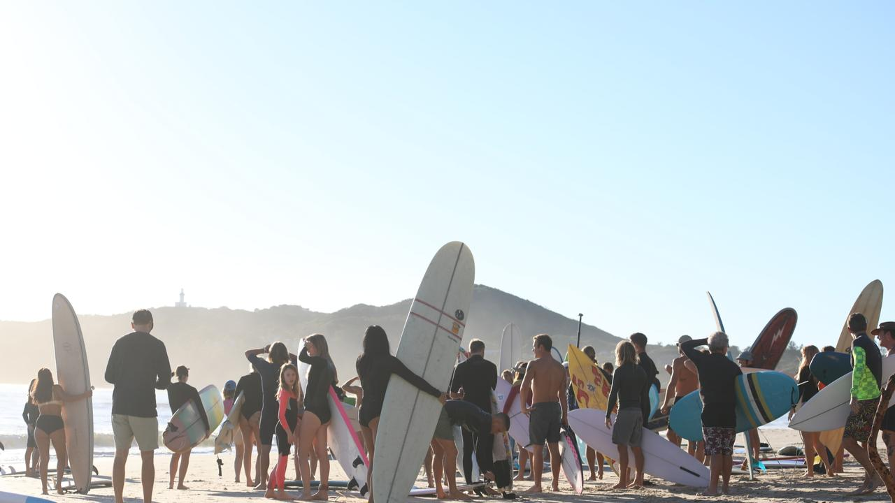Members of the public took part in a paddle-out at Byron Bay's Main Beach to protest against the planned Netflix reality show Byron Baes on the morning of Tuesday, April 20, 2021. Picture: Liana Boss