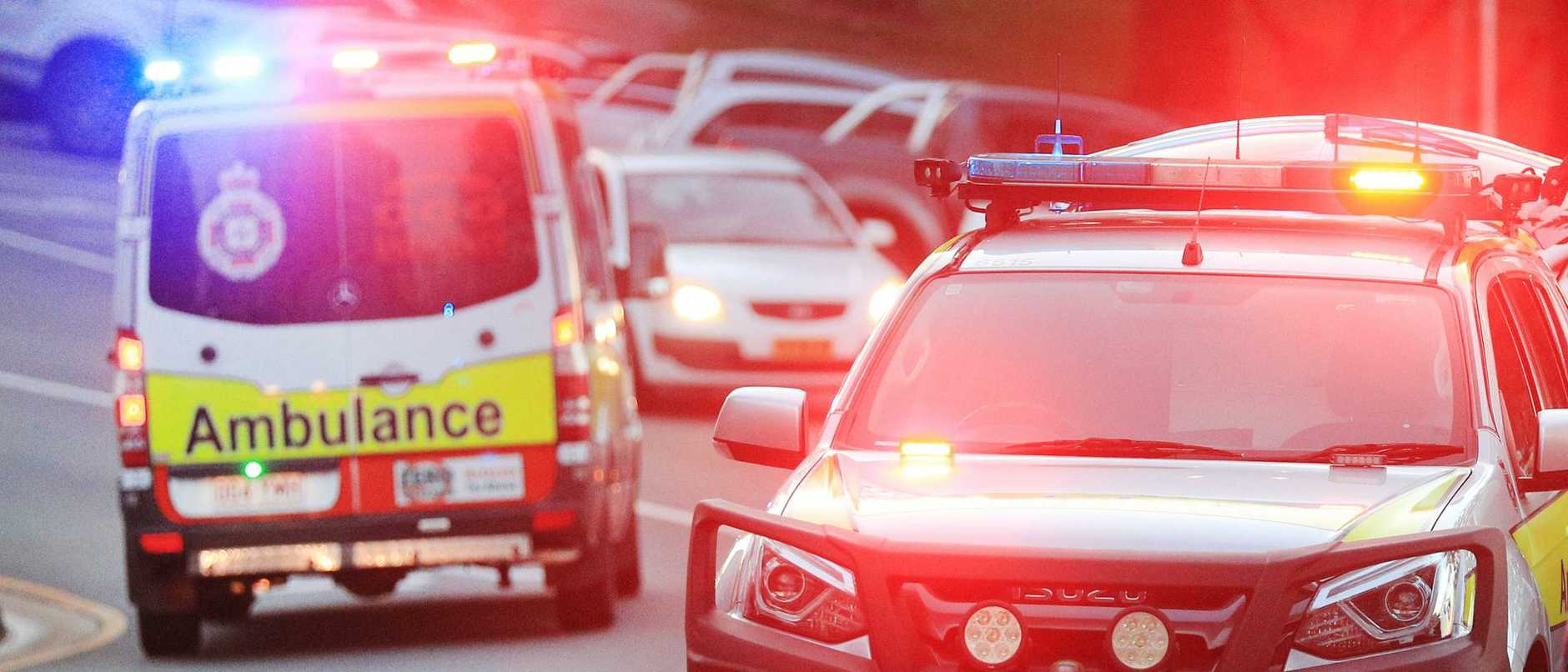 Man reported 'rolling around in pain' by side of M1 after two-vehicle crash at Stapylton on Tuesday morning