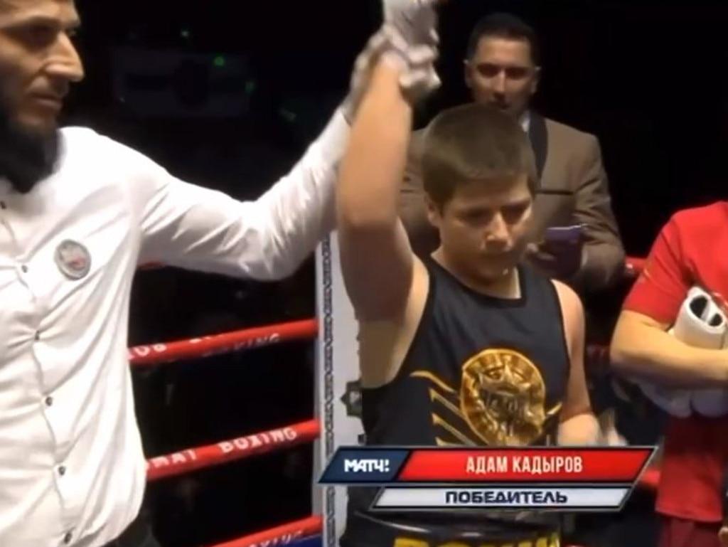 Adam Kadyrov has his hand raised as the winner.