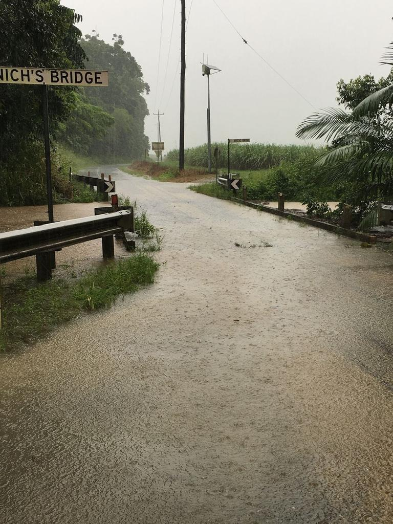 Rising flood water at Anichs Bridge in Mossman, Far North Queensland. PHOTO: Supplied.