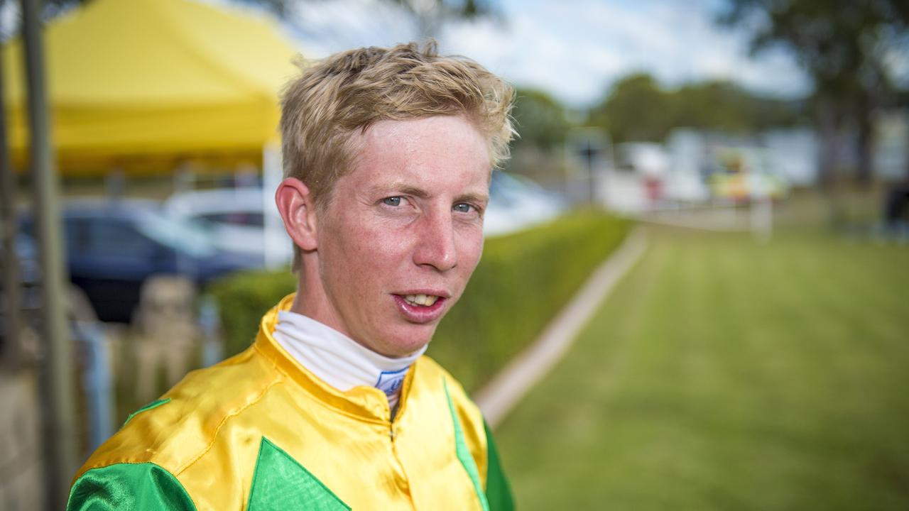 Jockey Chris McIver at the Past Brothers Junior Rugby League race day in 2014. Photo Luka Kauzlaric/The Observer.