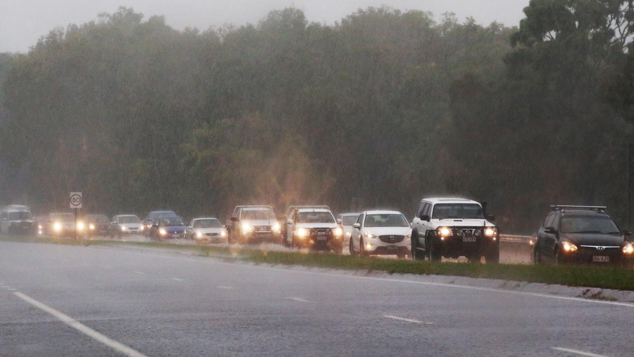 Heavy rain has been falling across Cairns and the far north, slowing traffic and causing congestion on the roads. Picture: Brendan Radke