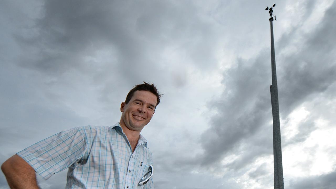 Rockhampton Duty Weather Observer Benj Blunt looks towards the sky as a technician repairs a tower struck by lightning during a storm. Photo: Chris Ison / The Morning Bulletin