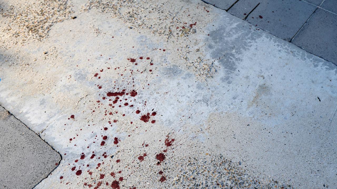 INJURED: Blood splatters a southwest Queensland pavement after a violent street fight west of Tara. Pic: Tara Croser.