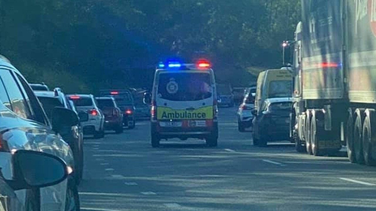 An ambulance rushes to scene of Warrego Highway crash at Riverview on Wednesday morning. Photo: Dave Cullen