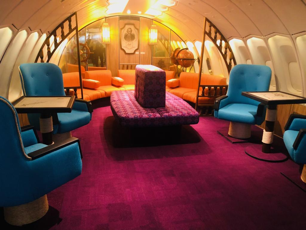 Qantas is giving flyers a taste of the groovy days of air travel, recreating the first class lounge that was part of its 747 aircraft in, the 1970s. Picture: Supplied