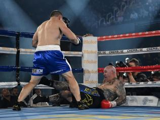 Lucas Browne slumps into the ropes.