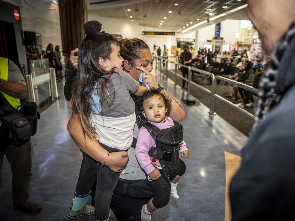 Families and friends reunited at Auckland Airport as the bubble began. Picture: Michael Craig/New Zealand Herald
