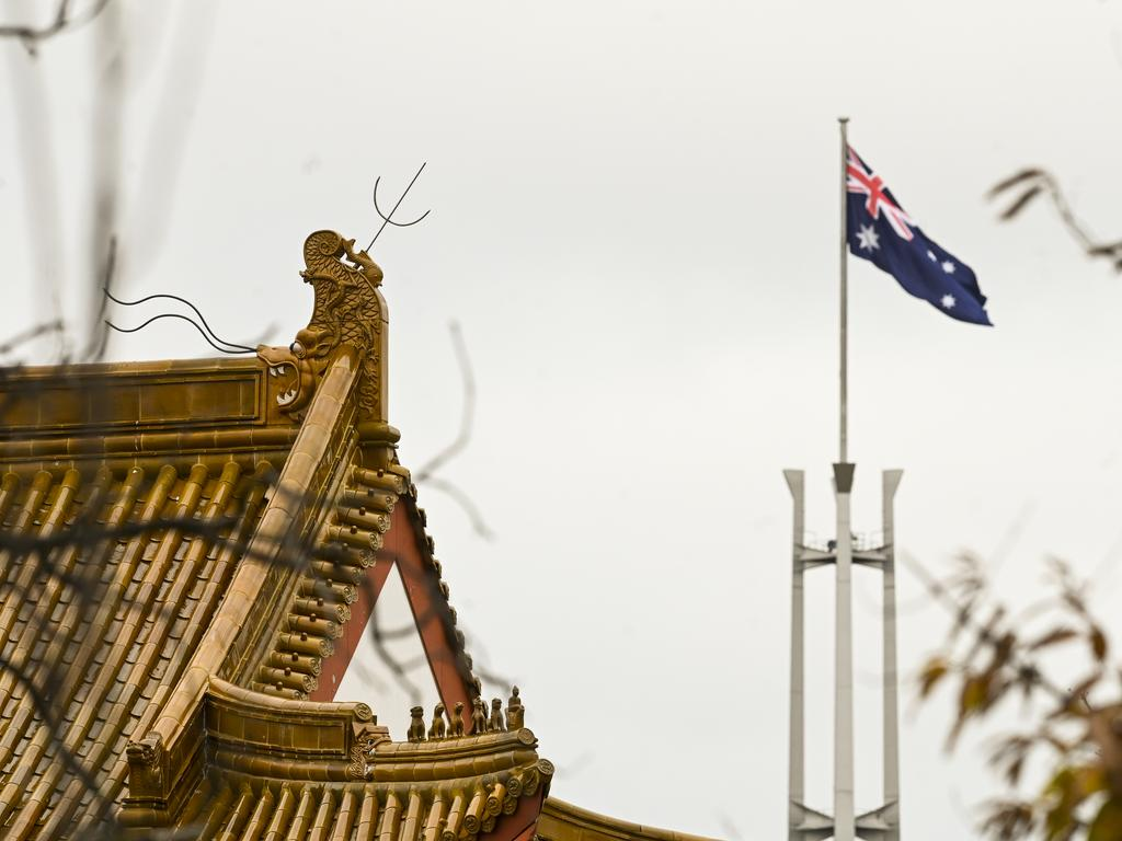The flagpole of the Australian parliament behind the roof of the Chinese Embassy in Canberra. Picture: AAP Image/Lukas Coch