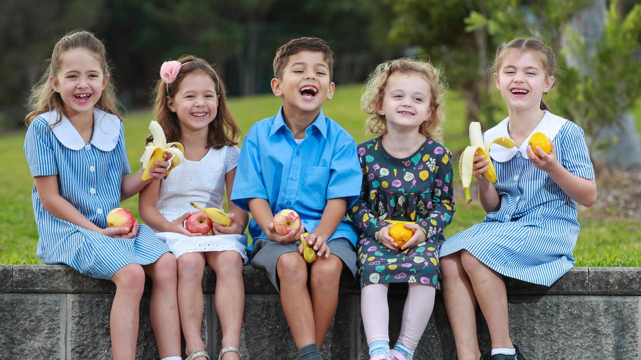 Rachael Huggins, 7, Chloe, 4, Lucas Costa Sigmond, 6, Lily Withey, 3, and Elizabeth Weston, 6, enjoying a laugh over some fruit. Picture: Justin Lloyd