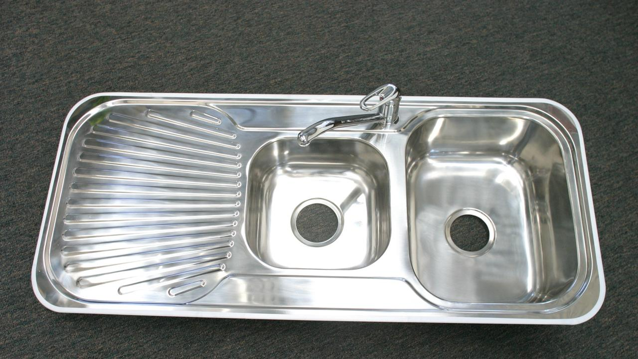 JULY 07, 2004: Generic picture of a stainless steel kitchen sink.  PicBrad/Wagner