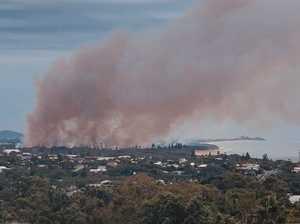 Plume of smoke covers Currimundi Lake in burn off