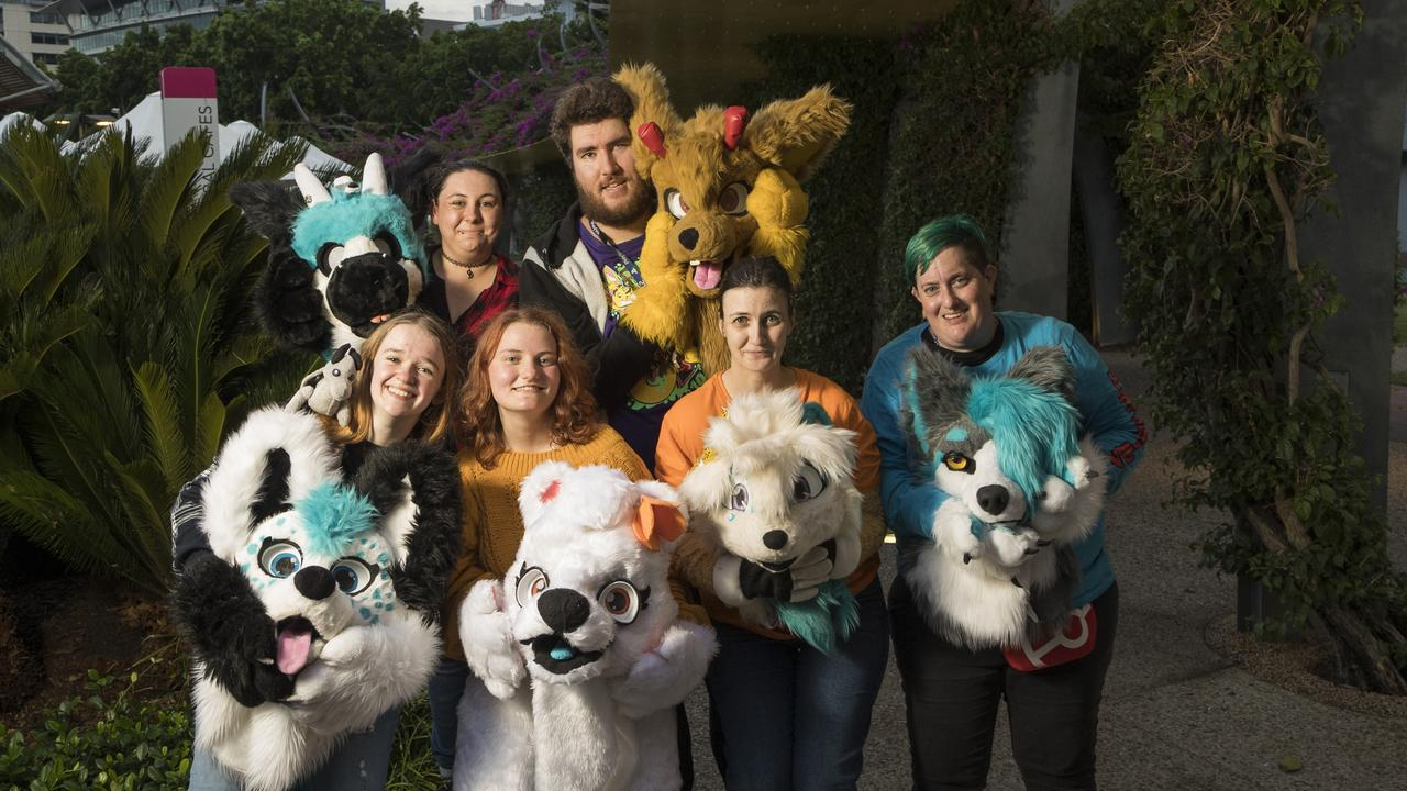 Unmasked: A group of furries, including Gabi, aka Skye, on the left, gather together to celebrate the furdom. Picture: Mark Cranitch