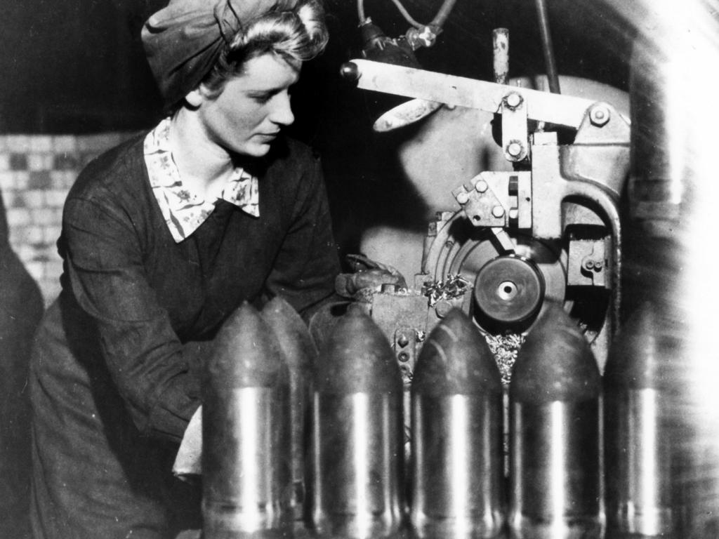 A woman working in a munitions factory during World War II