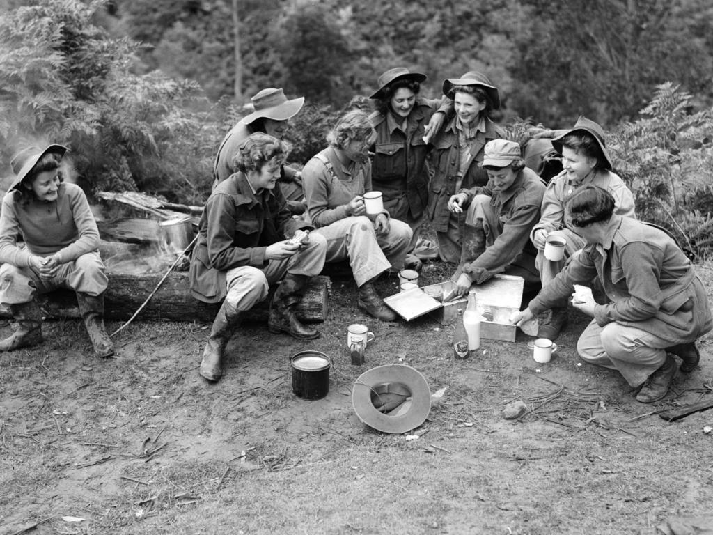 Land Army fruit pickers enjoying a break in 1945