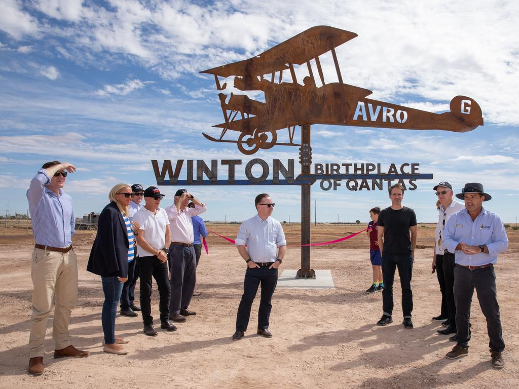 Qantas boss Alan Joyce, centre, hit the Outback to mark 100 years of Qantas.