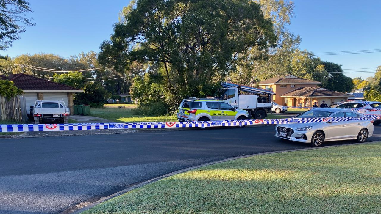 Police cordon off Mahogany St at Raceview following a house fire and disturbance early Friday morning.