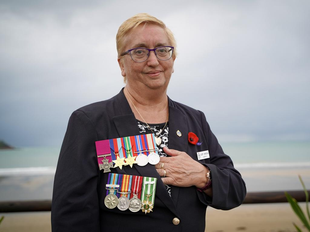 Judith Sheehan, the niece of the late Teddy Sheehan, who received a posthumous Victoria Cross for his heroic actions 78 years after dying in battle during World War II. Pictured at the Half Tide Beach Dawn Service, Anzac Day 2021, wearing Teddy's medals (top) and her late husband William Sheehan's medals. Picture: Heidi Petith