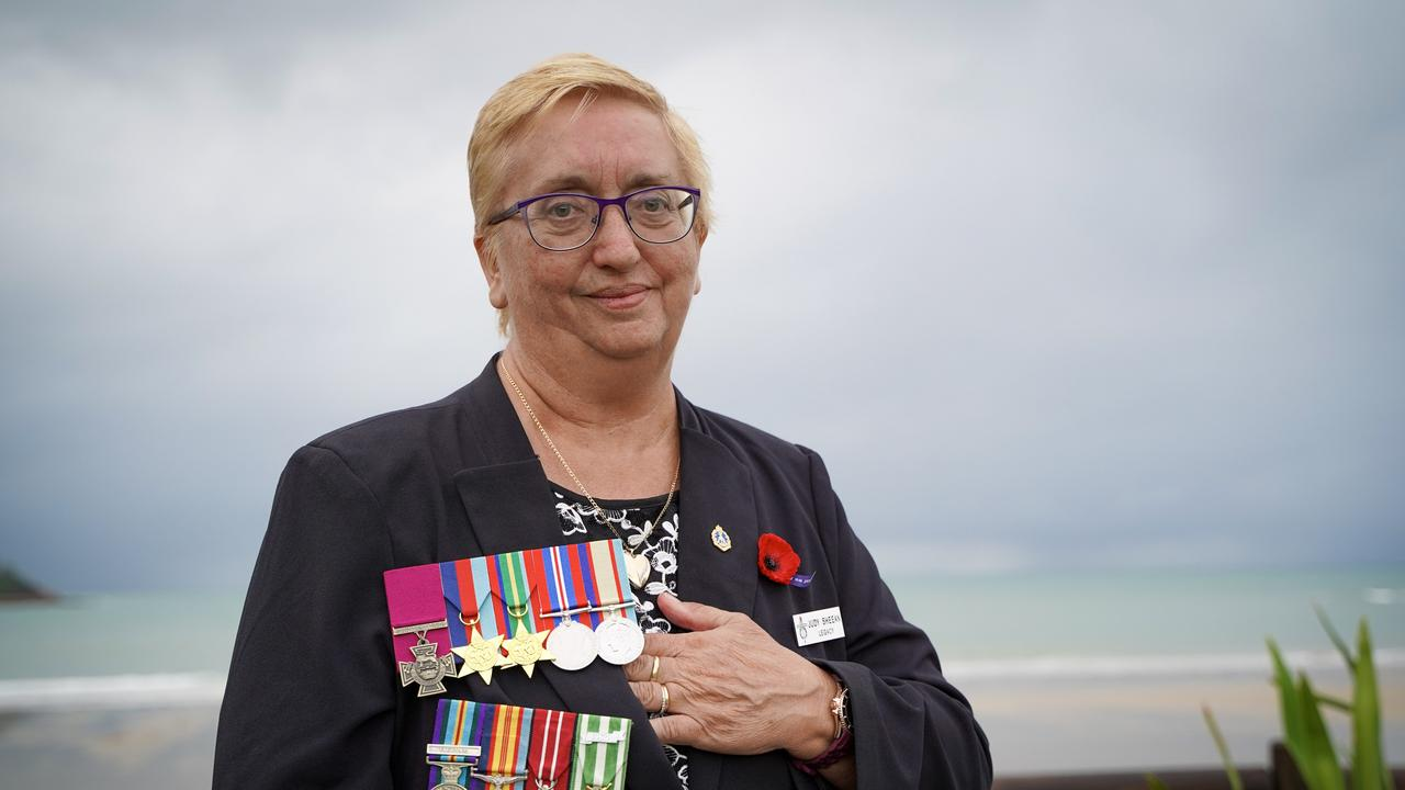 Judith Sheean, the niece of the late Teddy Sheean, who received a posthumous Victoria Cross for his heroic actions 78 years after dying in battle during World War II. Pictured at the Half Tide Beach Dawn Service, Anzac Day 2021, wearing Teddy's medals (top) and her late husband William Sheean's medals. Picture: Heidi Petith