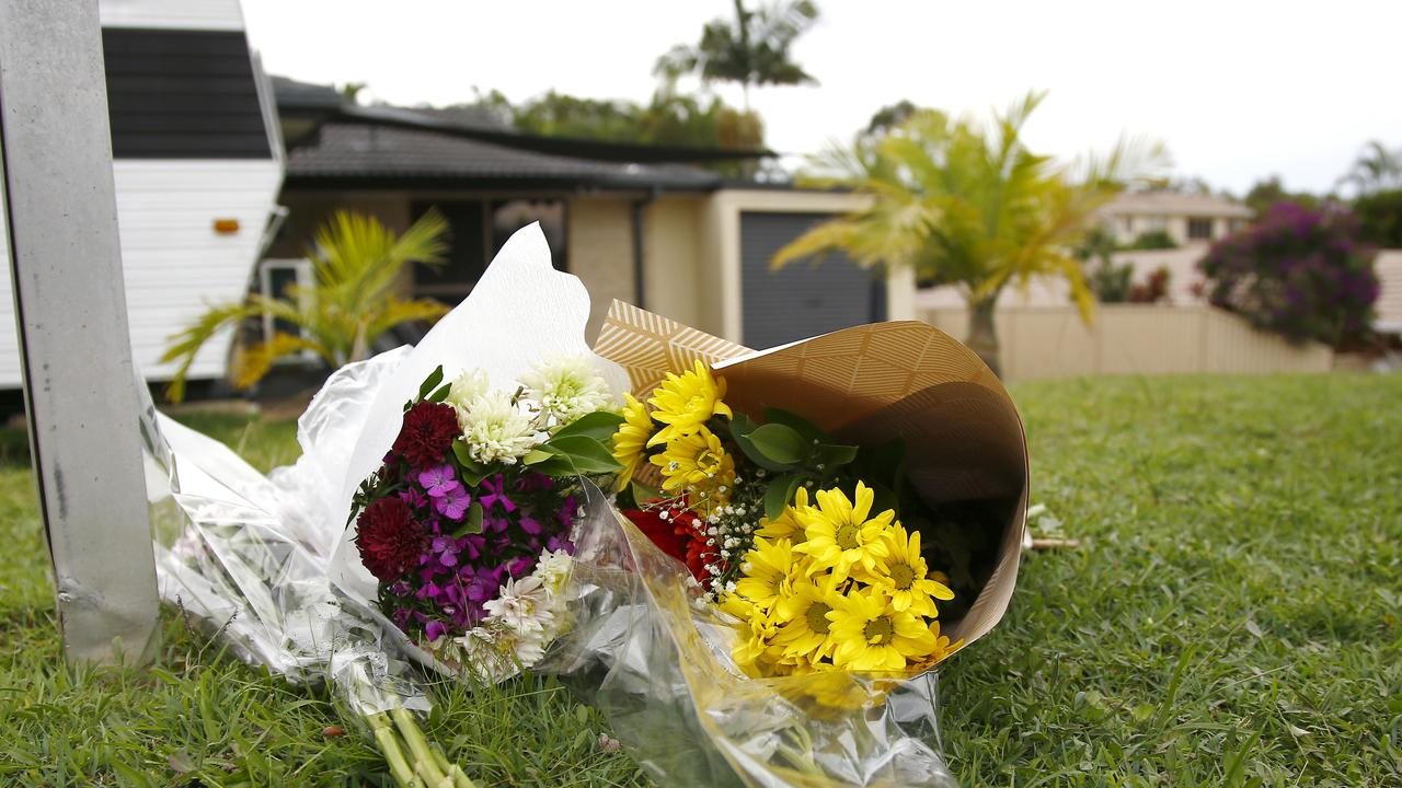 Floral tributes outside the home where Kelly Wilkinson was set on fire. Picture: Tertius Pickard