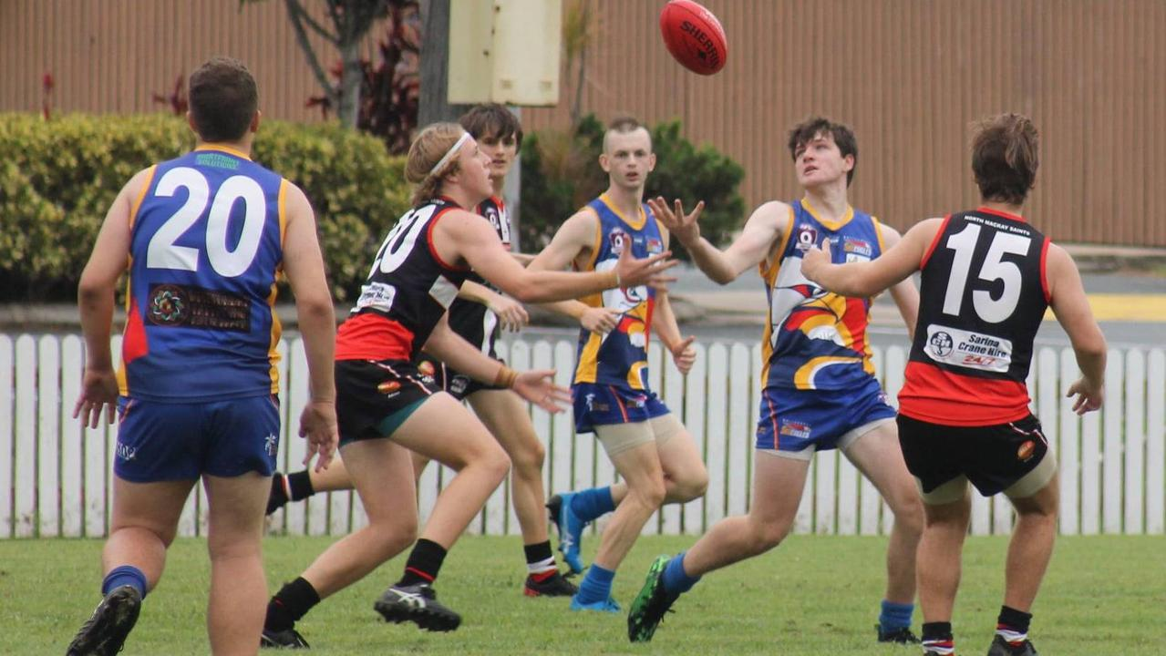 U17 Sea Eagles fight for a slippery footy. Photo: Kylie Allen