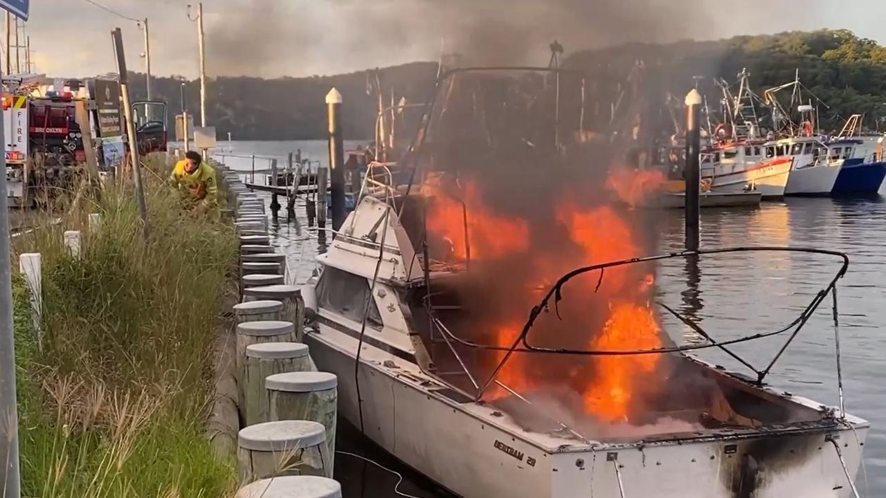 Six people were taken to hospital with burns when the 28 foot cruiser exploded into flames at Brooklyn Marina on the Hawkesbury River. Picture: Greg Manning
