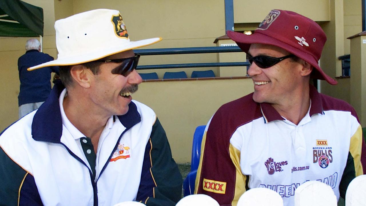 Former Australian coach John Buchanan and ex-Queensland coach Bennett King share a joke.