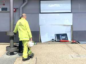 Car smashes through newsagent's wall at shopping centre