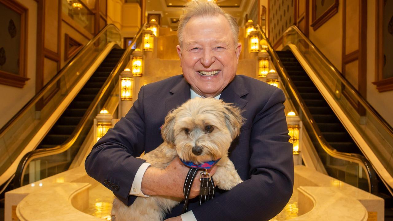 Peter Hitchener with Jo Hall's dog Harley at the Langham Hotel. Pic: Darren McNamara