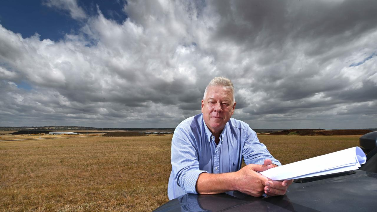 A frustrated John Wagner, holding site plans, on the area at his Wellcamp Airport where he wants to immediately build a COVID quarantine facility. Picture: Lyndon Mechielsen/The Australian