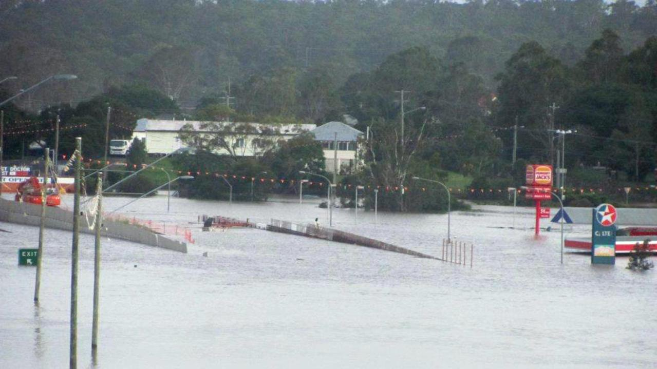 Hungry Jacks and Caltex servo at Goodna during the 2011 floods. Goodna was one of the worst hit areas. Photo: Contributed, Lubo Jonic Goodna