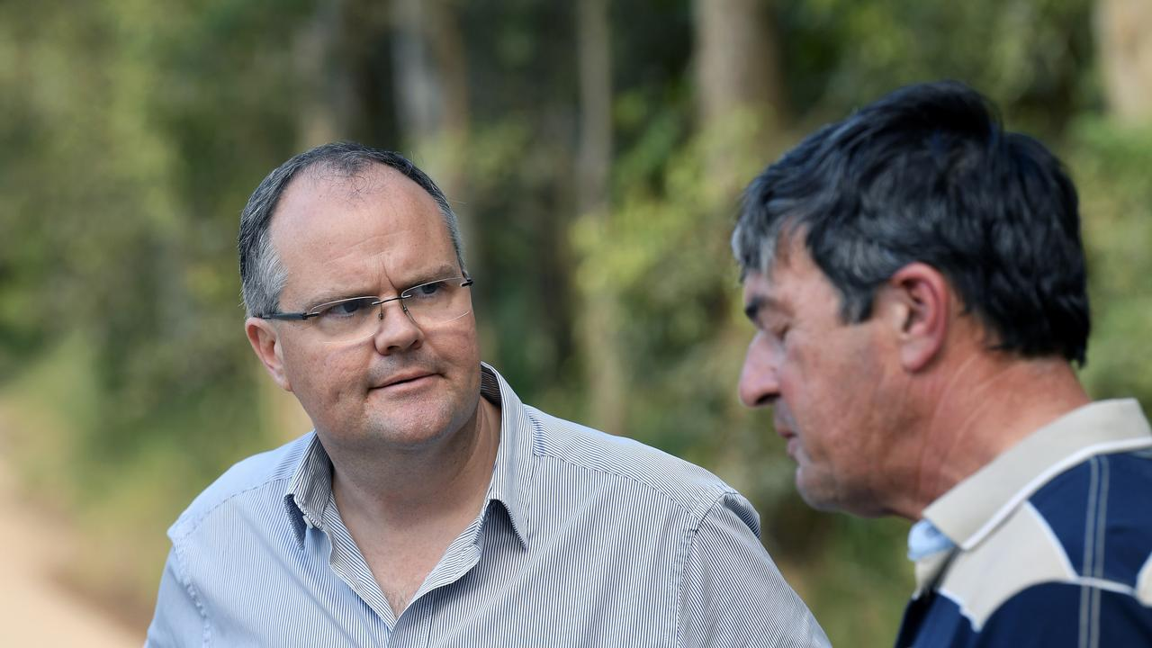 Yandina Creek resident Angelo Reitano is thrilled the dirt road that leads to his property will be sealed after 30 years of campaigning to have the work done. Pictured with Ted O'Brien (left). Photo: Patrick Woods.