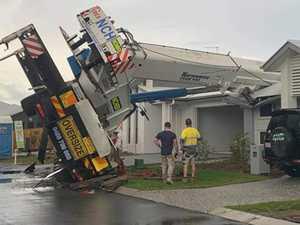 Residents inside as crane crashes onto three Coast homes