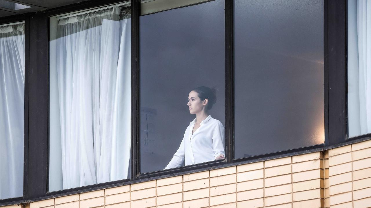 A woman looks out from her window at the quarantine hotel Holiday Inn at Melbourne Airport. Picture: NCA NewsWire / Ian Currie