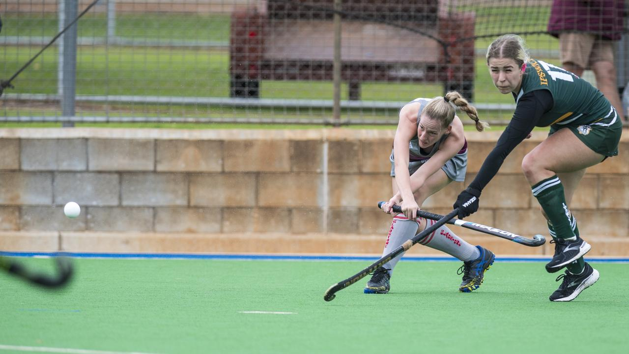 Megan Groves (left) of Gladstone and Gabby Nicholls of Ipswich in Hockey Queensland Championships at Clyde Park, Sunday, May 2, 2021. Picture: Kevin Farmer