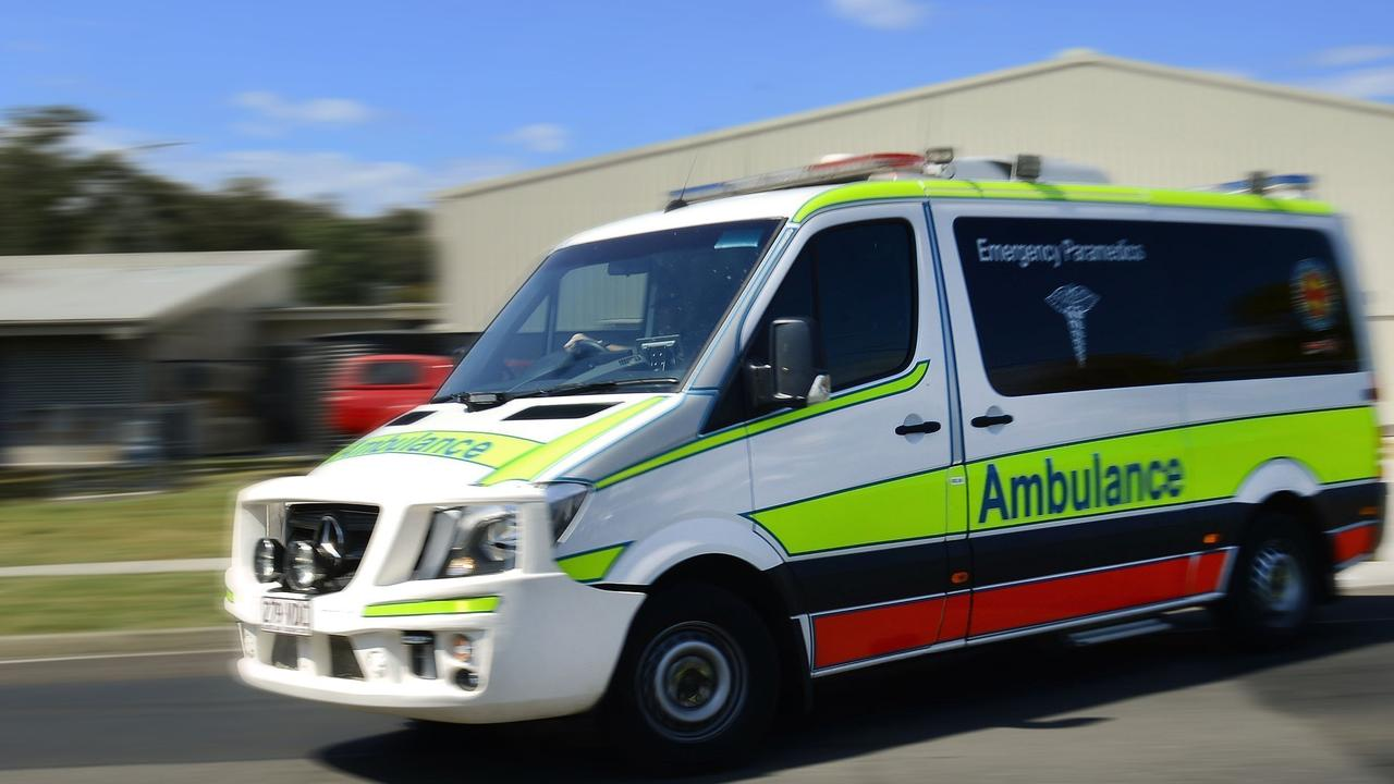 Paramedics are assessing three people at a crash along Steve Irwin Way