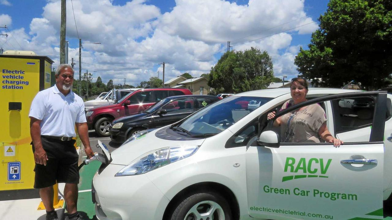 RACV Noosa Resort's David Olopai charges a resort Nissan Leaf electric vehicle with Danielle Taylor of the Cooroy Chamber of Commerce.