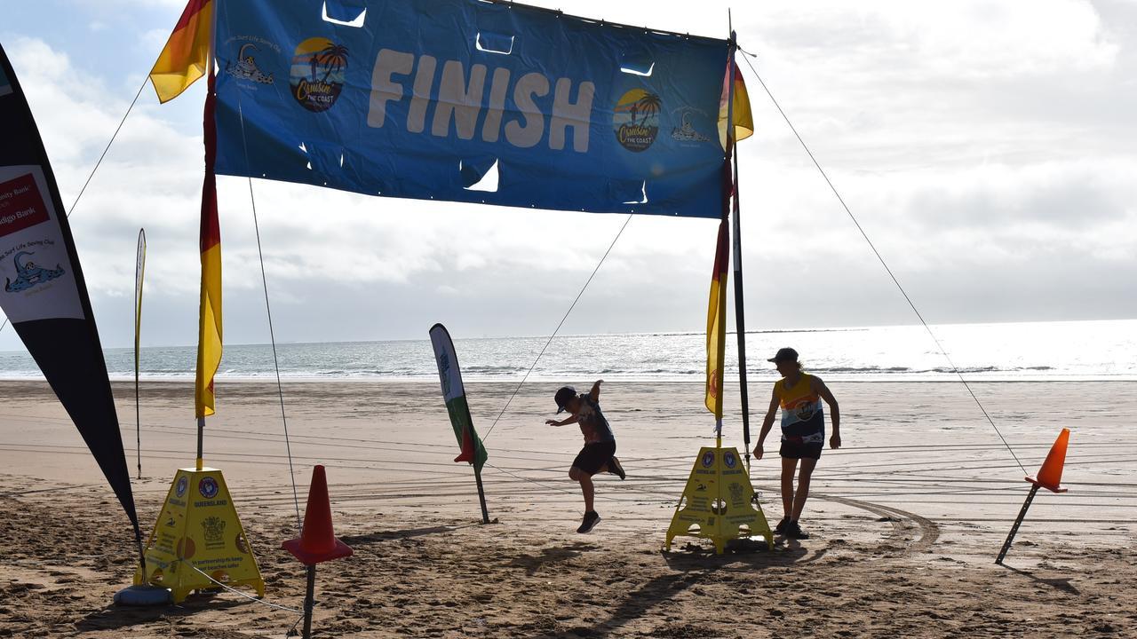 Children playing on the finish line at Sarina's Cruisin' the Coast Fun Run, 2021. Picture: Lillian Watkins