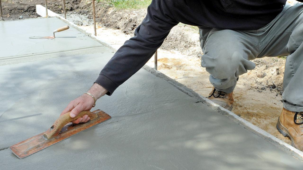 The Queensland Building and Construction Commission is warning people not to engage the services of unlicensed concreter Jacob Moratti, who is operating in the state. Picture: generic concrete laying (not Jacob Moratti pictured)