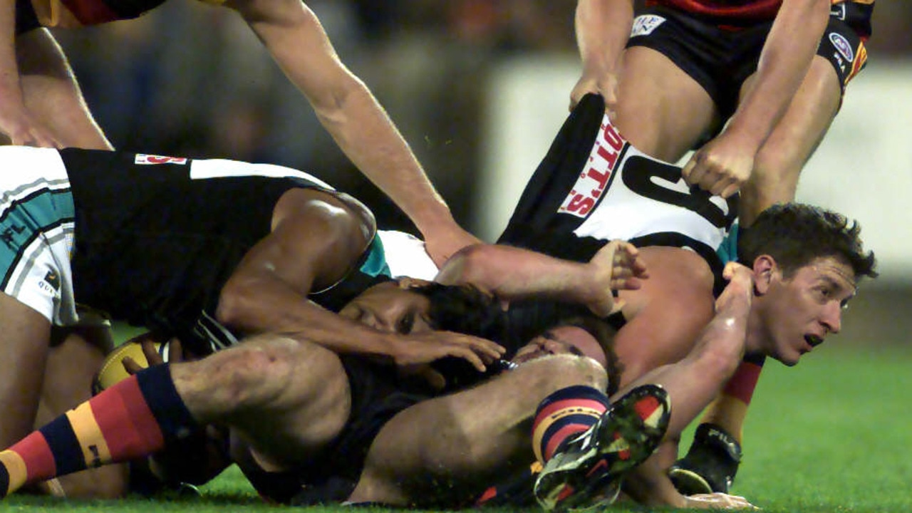 Mark Ricciuto and Josh Carr go at it on the field during the Round 5 Showdown in 2002.