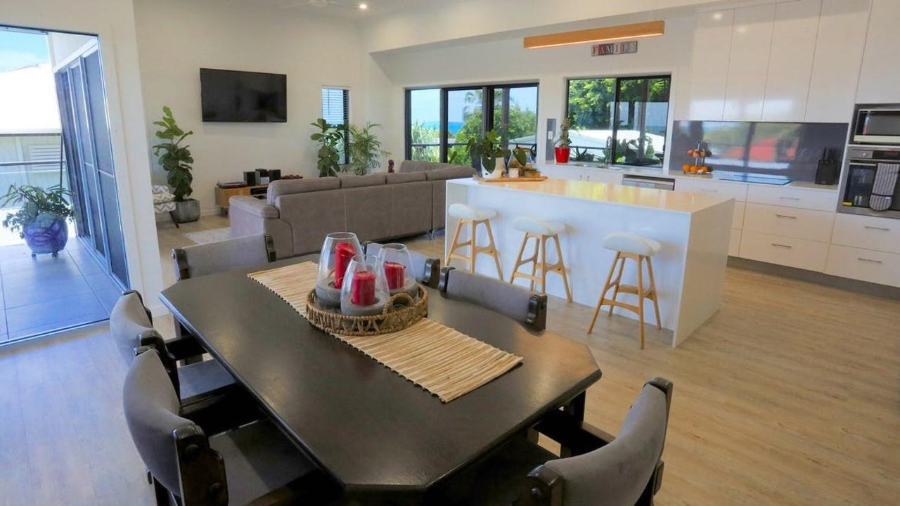 The home boasts an open living space with ocean views that flows onto the front patio. Picture: Contributed